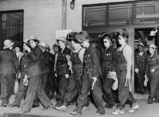 Denim-clad female workers leaving the factory.